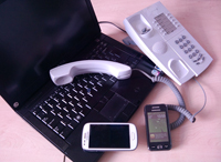 Communication tools - Two mobile phones, a landline phone and a laptop