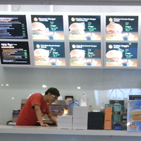 A student working in a food outlet